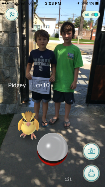 Parishioners at Christ Church, Coronado, in the Diocese of San Diego play Pokemon at the church's front gate. Photo: Christ Church