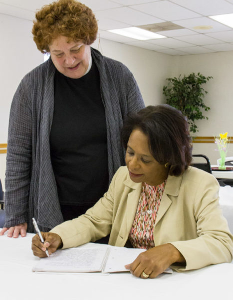 The Rev. Patricia Riggins, left, and Regina Walker confer over a pen pal notebook. Photo: Diocese of West Texas