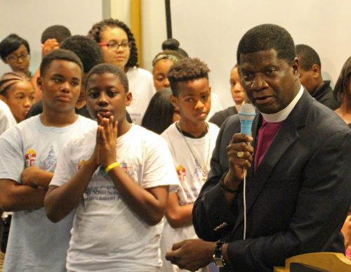 Bishop Eugene Sutton tells the scholars at the end of their four week summer program they are now part of a larger family of people who are investing in their success. Photo: Diocese of Maryland