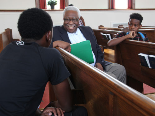 Waymon Wright meets his two scholars, Mekhi Stevens, left, and Da'Sean Washington. Both were impressed Wright met the Rev. Dr. Martin Luther King, Jr. at Morehouse College. Wright will keep in touch with both scholars during their high school careers. Photo: Diocese of Maryland