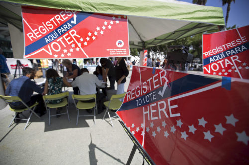 Signs are pictured during a voter registration drive for National Voter Registration Day outside Convention Center in Los Angeles, California Sept. 22, 2015. Photo: REUTERS/Mario Anzuoni
