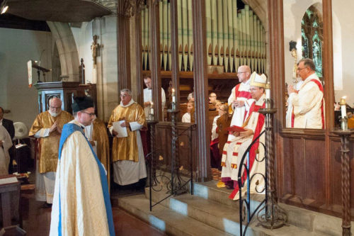 At his institution as rector of St. John the Evangelist Episcopal Church, the Rev. Nathan J.A. Humphrey stands before the Rt. Rev. W. Nicholas, Knisely, Bishop of Rhode Island. Photo Zach Allen