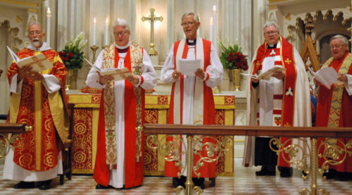 Clergy gather before the altar for the investiture of Bishop Skip Adams, left, on September 10, 2016. With him are (left to right) Bishop Dean E. Wolfe, Vice President of the House of Bishops and Bishop of the Episcopal Diocese of Kansas; Bishop Charles G. vonRosenberg, the outgoing Provisional Bishop of the diocese; The Very Reverend Michael Wright, Dean of Grace Church Cathedral; and Bishop J. Michael Garrison, retired 10th Bishop of the Diocese of Western New York.