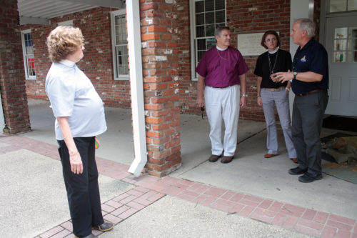 Louisiana Bishop Morris K. Thompson, the Rev. Canon Shannon Manning, canon to the ordinary in the Diocese of Louisiana, and the Rev. Elaine Clements, a deacon and the diocese's disaster and preparedness coordinator, during a visit to St. Francis in Denham Springs. Photo: Karen Mackey/Diocese of Louisiana
