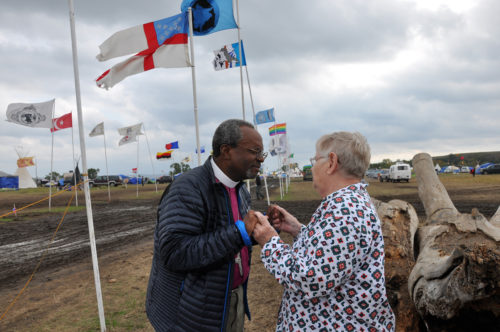 "Leona Volk, of St. Mark's Episcopal Church in Aberdeen, South Dakota, greets Presiding Bishop Michael Curry Sept. 24 at Oceti Skowin Camp. Volk has grandchildren who live on the Standing Rock Sioux Reservation near where the Dakota Access Pipeline would pass. ""It's got to stop here, now,"" she said. Photo: Mary Frances Schjonberg/Episcopal News Service"