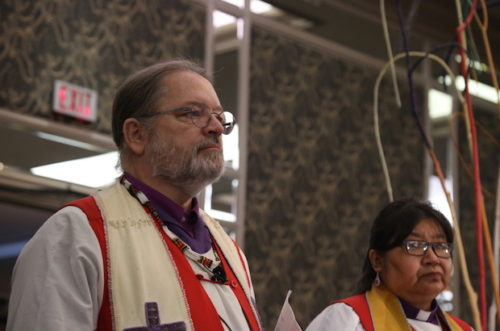 National Indigenous Anglican Bishop Mark MacDonald, left, and Bishop Lydia Mamakwa, of the Indigenous Spiritual Ministry of Mishamikoweesh,  during the opening worship at General Synod 2016. Photo: Art Babych