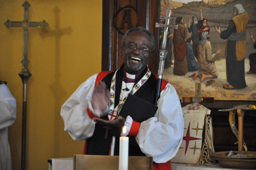 Presiding Bishop Michael Curry reacts Sept. 25 to being told that the people of St. James Episcopal Church in Cannon Ball, North Dakota, gathered at the church on Nov. 1, 2015 to watch a broadcast of him being installed as the 27th presiding bishop of the Episcopal Church. Photo: Mary Frances Schjonberg/Episcopal News Service