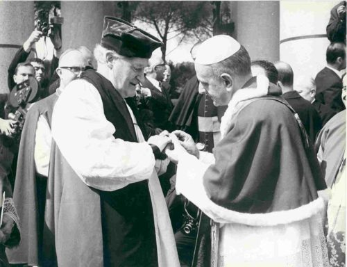 Pope Paul VI places his episcopal ring on Archbishop of Canterbury Michael Ramsey's finger during their 1966 meeting.