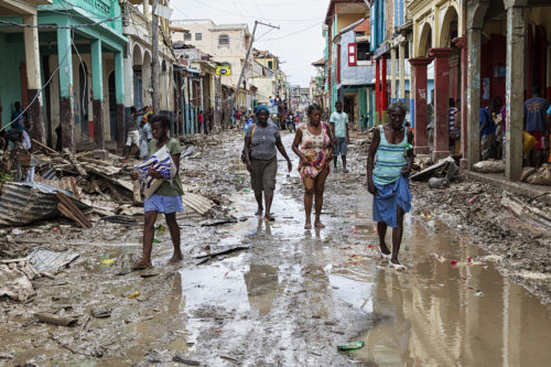 People walk along a street in downtown Jeremie, Haiti, Oct. 6, two days after Hurricane Matthew made landfall nearby. While the capital Port-au-Prince was mostly spared from the full strength of the class 4 hurricane, the western cities of Les Cayes and Jeremie received Matthew's full force.  Photo: Logan Abassi UN/MINUSTAH