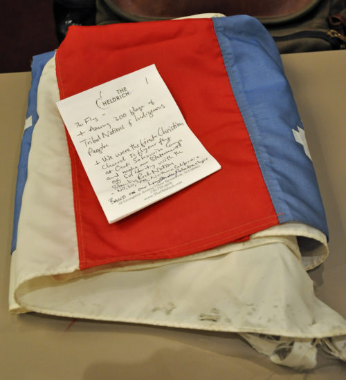 The Episcopal Church flag that flew over the Dakota Access Pipeline camp in North Dakota lays folded for its journey to the Archives of the Episcopal Church in Austin, Texas, along with the Rev. John Floberg's notes from his presentation of the flag. Photo: Mary Frances Schjonberg/Episcopal News Service