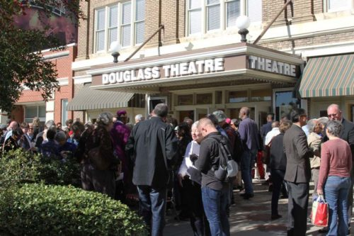 "An Oct. 22 pilgrimage of 175 people to the historic Douglass Theatre in Macon, Georgia, marked the location where in 1922 a lynch mob discarded the body of lynching victim John ""Cockey"" Glover. Built by African- American entrepreneur Charles Douglass, the theater was a popular gathering place for the community and Glover's body was dumped there ""to make a statement,"" said Theatre Director Gina Ward. The pilgrimage, sponsored by the Episcopal Diocese of Atlanta's Beloved Community Commission for Dismantling Racism, sought to heal from racism by bearing witness. Photo: Hala Hess White"