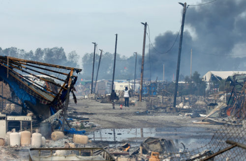 "A view shows the charred debris from makeshift shelters and tents in the ""Jungle"" on the third day of the evacuation of migrants and transfer to reception centers in France, as part of the dismantlement of the camp in Calais, France, Oct. 26. Photo: REUTERS/Pascal Rossignol"