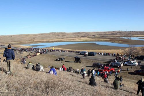 The interfaith witness formed a huge Niobrara Circle of Life just south of the backwater bridge where on the other side law enforcement officers kept watch. Opponents of the Dakota Access Pipeline have held the bridge since law enforcement on Oct. 24 cleared a newly set up protest camp. Photo: Lynette Wilson/Episcopal News Service