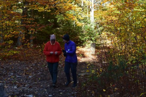Susan Fogleman, left, and Wendy Weiger walk to the service at Church of the Woods on an October Sunday. Photo: Heather Beasley Doyle