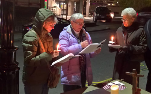 Pat O'Connell, cnter, a deacon postulant from Church of the Epiphany, Wilbraham, Massachusetts, reads during an election eve vigil service outside Christ Church Cathedral in Springfield, Massachusetts. Photo: Eric Elley