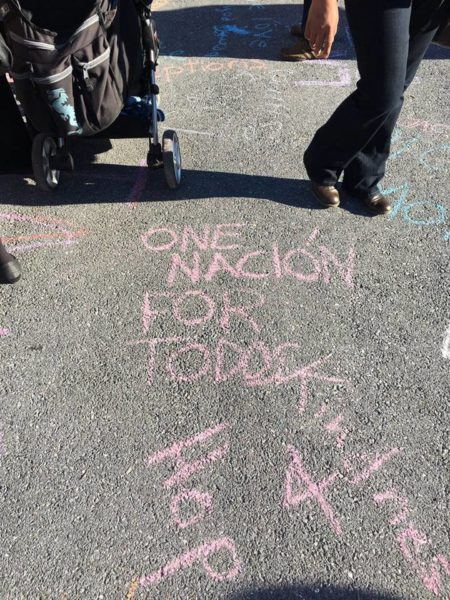 "Following the Nov.13 Spanish-language mass at Church of Our Saviour, attendees used chalk to write messages of love, peace and welcome on sidewalks and the street outside the church. Here written in pink chalk read ""One Nación For Todos"" or ""One Nation For All"" in Spanish and English. Photo: Facebook"