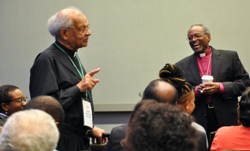 The Rev. John Carlton Hayden of Washington, D.C., recalls a moment when both he and Presiding Bishop Michael Curry were young priests. Hayden spoke during a Nov. 15 open mic session during the evening prior to the start of the Nov. 16-19 Episcopal Church International Black Clergy Conference in Houston, Texas. Photo: Mary Frances Schjonberg/ Episcopal News Service