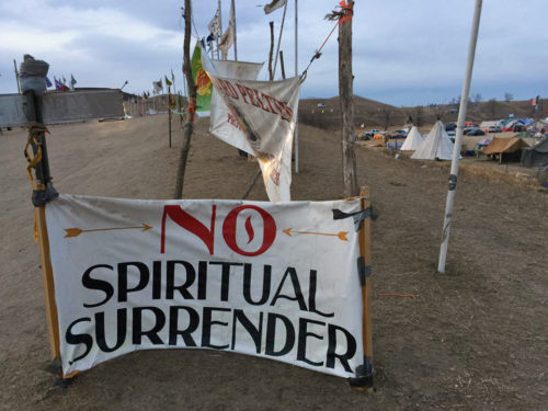 Signs of encouragement and support fill the Oceti Sakowin camp. Photo: Jonathan Hanneman via Facebook