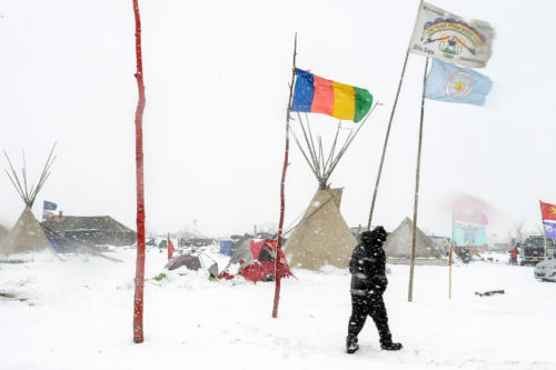 The Oceti Sakowin camp is seen in a Nov. 28 snow storm during a protest against plans to pass the Dakota Access pipeline near the Standing Rock Indian Reservation, near Cannon Ball, North Dakota. Photo: REUTERS/Stephanie Keith