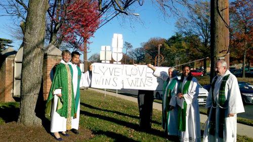 Our Saviour love wins sign