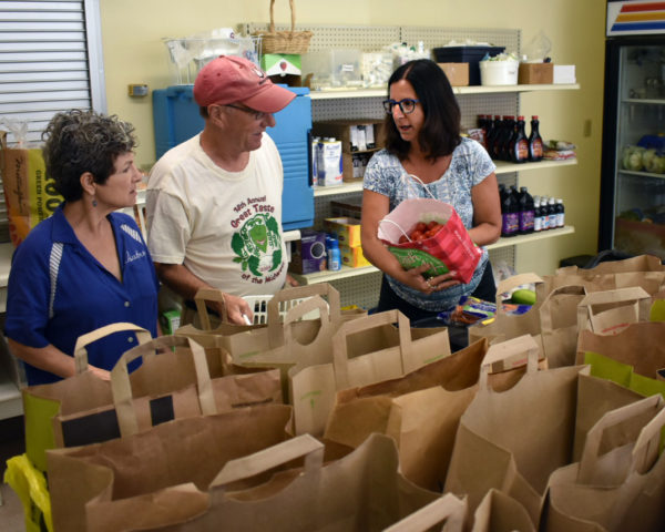 Vikki and bags at Grace Food Pantry