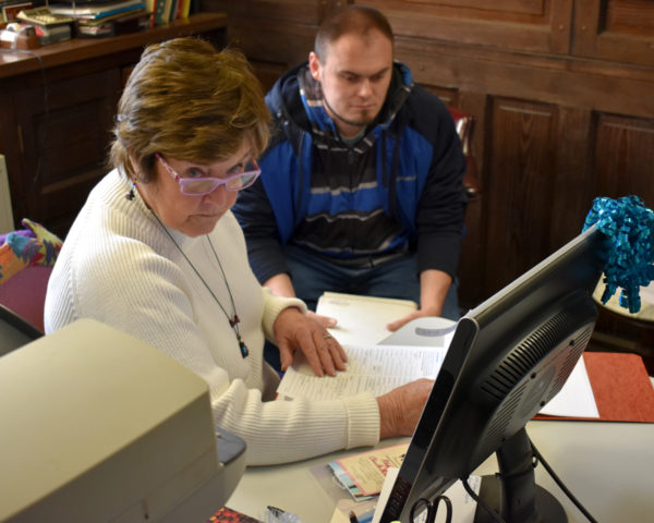 Linda looks at paperwork