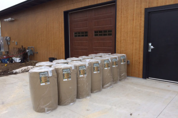 Rain barrels lined up