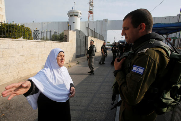 Palestinian woman at Israeli checkpoint