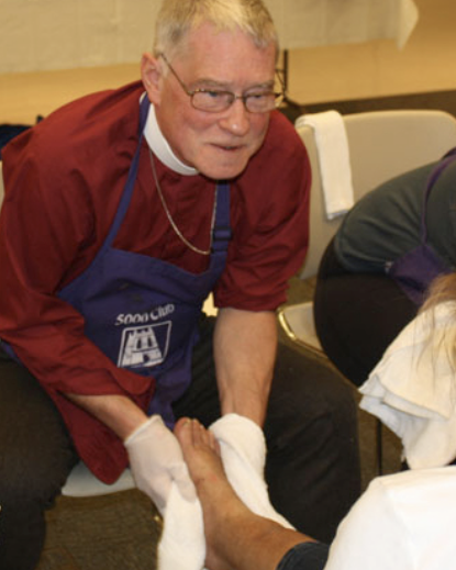 Bishop Breidenthal washing feet