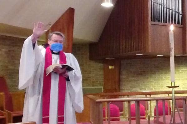 Rev. McVey leads service