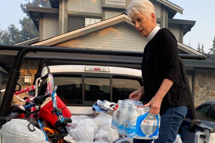 Debra Savino unloads water